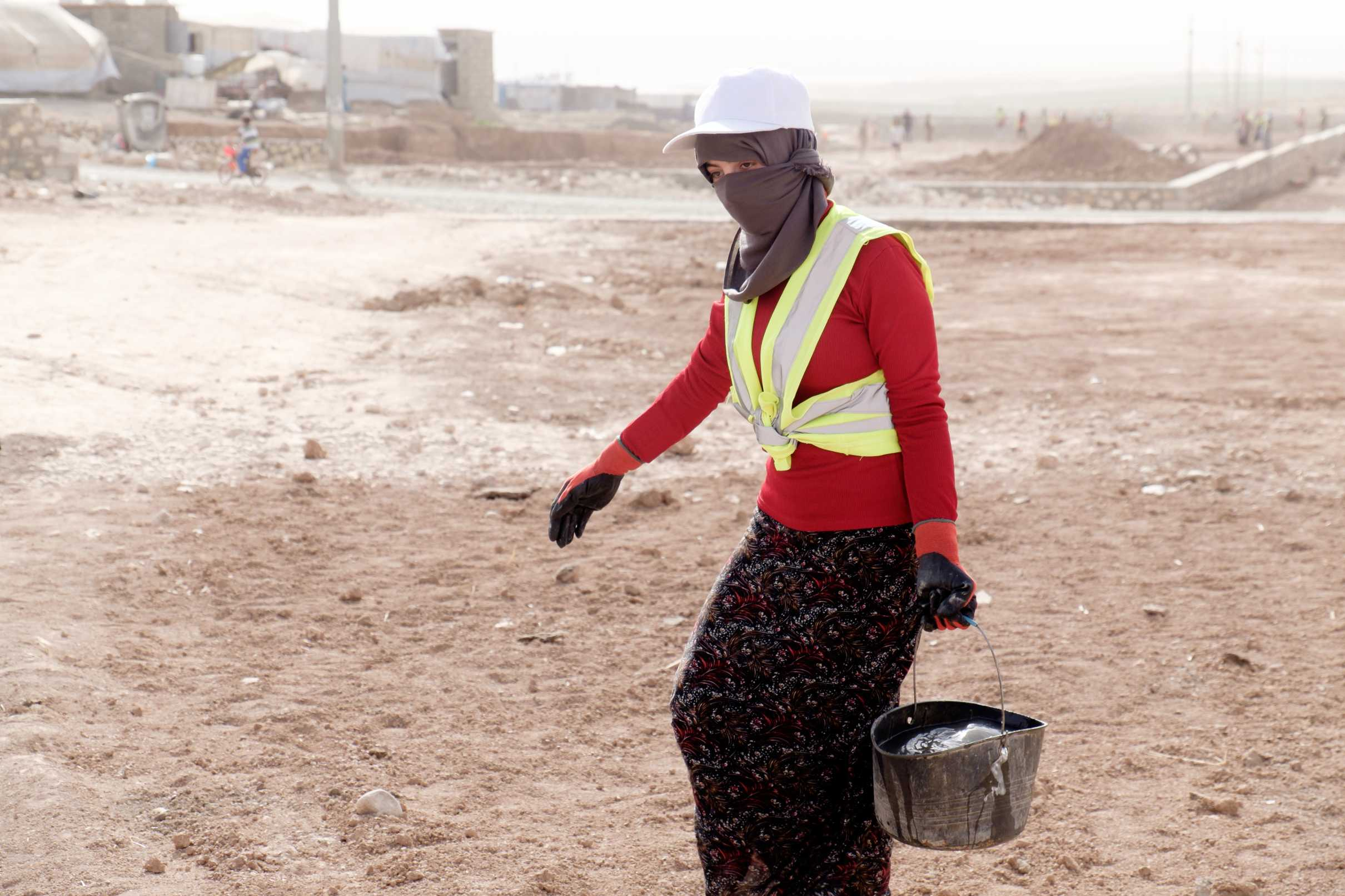 Female worker at a Cash for Work activity inside the Camp